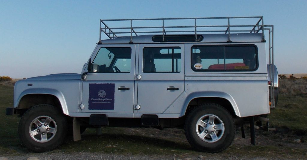 Silver Land Rover Defender with Cornish Heritage Safaris logo