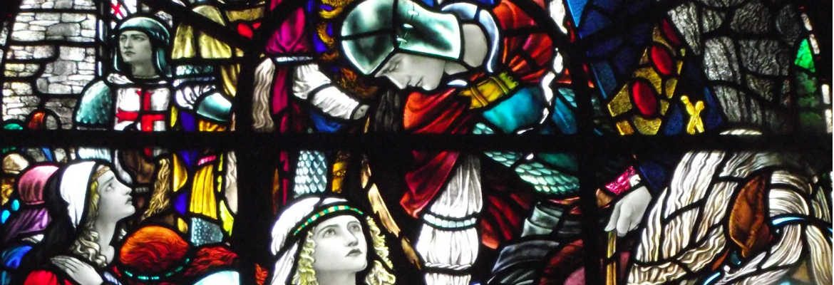 Stained glass image of knight and maiden, King Arthur's Great Halls Tintagel, Cornwall