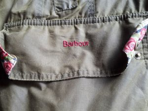 Barbour logo on green wax jacket