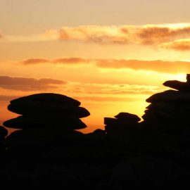 Sunset behind a granite tor on Bodmin Moor